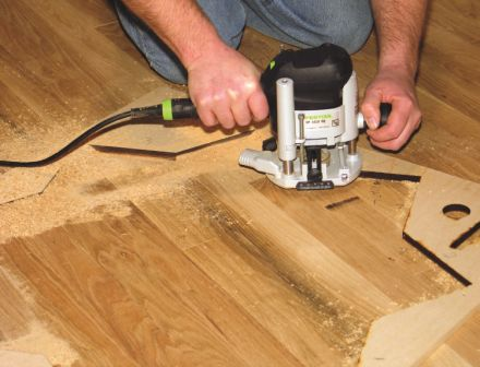 Photo 4: Make at least three to four passes at increasing depths to avoid overheating and damaging the router bit.